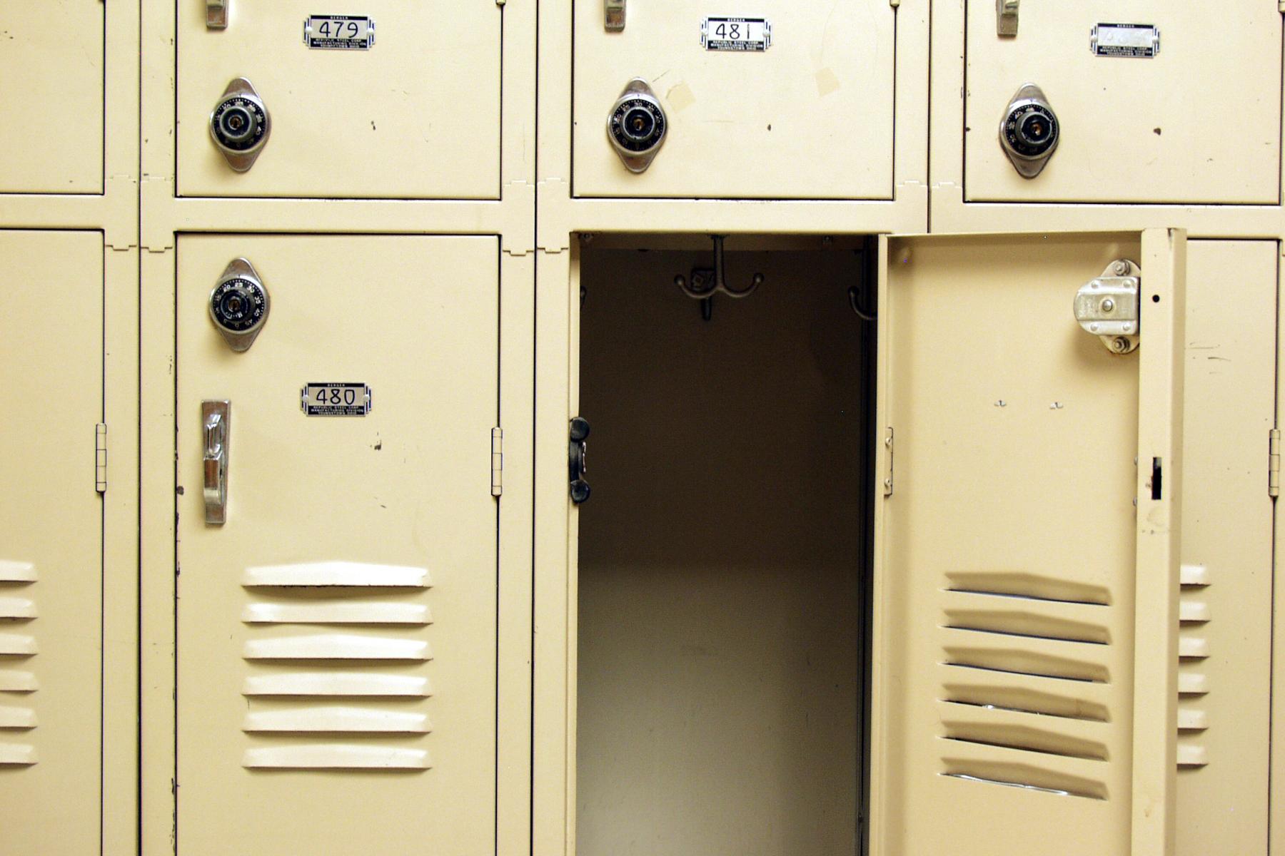 Metal lockers in school with door open
